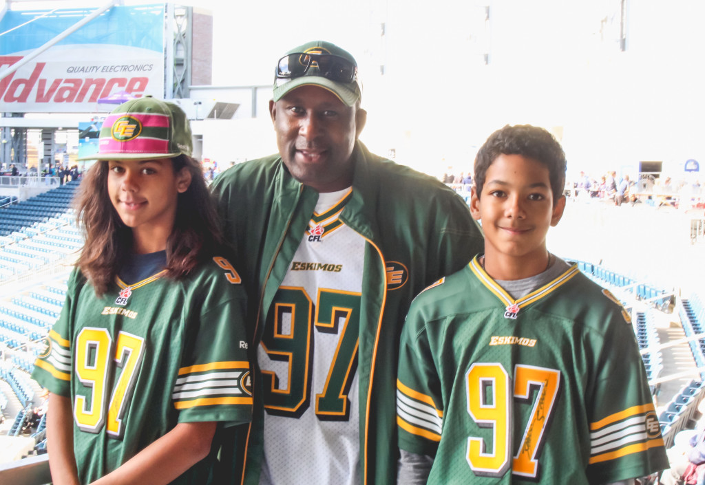 Eddie Steele's family and biggest fans travel across Canada to watch him play for the Edmonton Eskimos. Left to right: Raia Steele, Leroy Steele, Draydon Steele. THE PROJECTOR/Laura Hayward