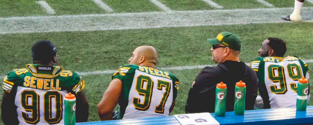 Eddie Steele sits on the sidelines with his Edmonton Eskimos teammates during the Oct. 3 game against the Winnipeg Blue Bombers at Investors Group Field.THE PROJECTOR/Laura Hayward