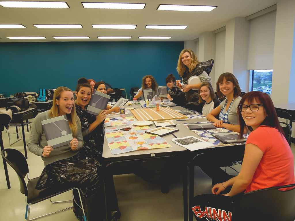 A class practices hosting a crafting event as part of the therapeutic recreation facilitator for older adults program. SUPPLIED