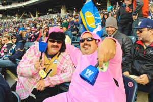 Marc Meyer (left) and Rene Meyer have their cowbells ready to cheer on the Bombers in their last home game of the 2015 season. THE PROJECTOR/ Laura Hayward