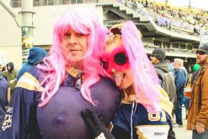 Jim and Di McDougall sport wild pink outfits during CFL Pink Week. THE PROJECTOR/Laura Hayward