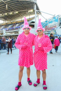 Derek Campbell (left) and Larry Solomon look right at home in their pink bathrobes at Investors Group Field during CFL Pink Week. THE PROJECTOR/Laura Hayward