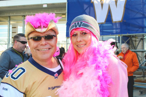 Kevin Muir and Colin Lenmasurier are pink and fluffy for the breast cancer awareness game at the IGF.  THE PROJECTOR/Laura Hayward