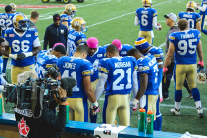 The Bombers show off their special pink skullcaps on the sidelines before playing the Ottawa REDBLACKS on Oct. 24. THE PROJECTOR/Laura Hayward