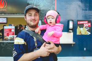 Chad Covertly and his daughter colour coordinated their outfits for the Oct. 24 Bomber game. Covertly shows off his blue and gold jersey, and his daughter rocks pink to help support women's cancer awareness efforts. THE PROJECTOR/Laura Hayward