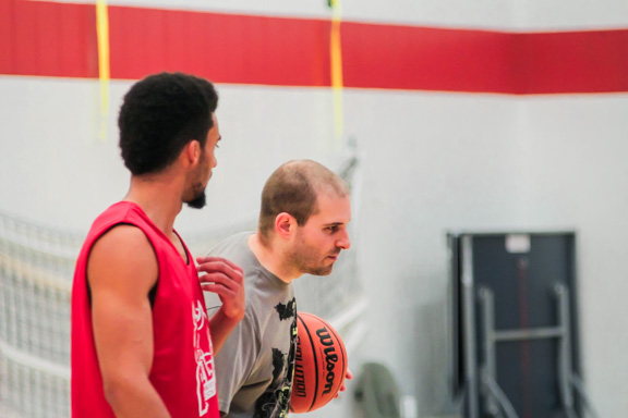 Scott Fitzpatrick (right) talks with Taylor Brown, a returning Rebels men's basketball player, during a team practice at NDC. THE PROJECTOR/ Erik Fjeldsted