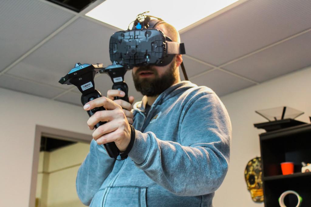 Lesley Klassen, 38, demonstrates the virtual reality painting program the Google Tilt Brush on the HTC Vive. THE PROJECTOR/ Cam Deamel