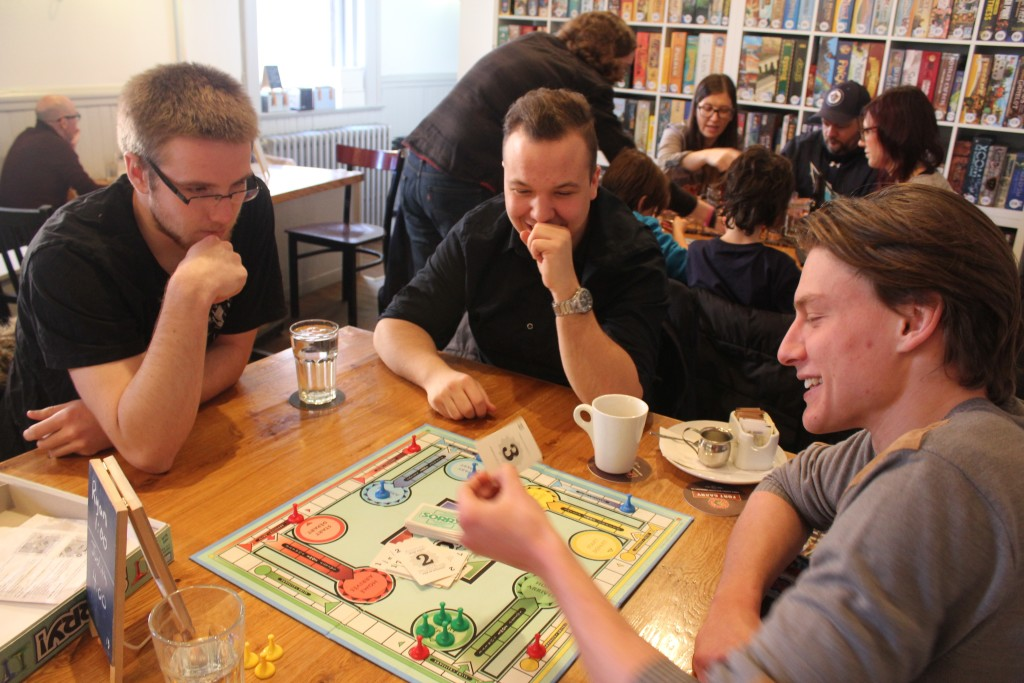 Ryan Levesque, Nathan Getty and Jordan Toews meet up once a month at Across the Board Game Café to drink some beer and play board games. THE PROJECTOR/Madelaine Lapointe