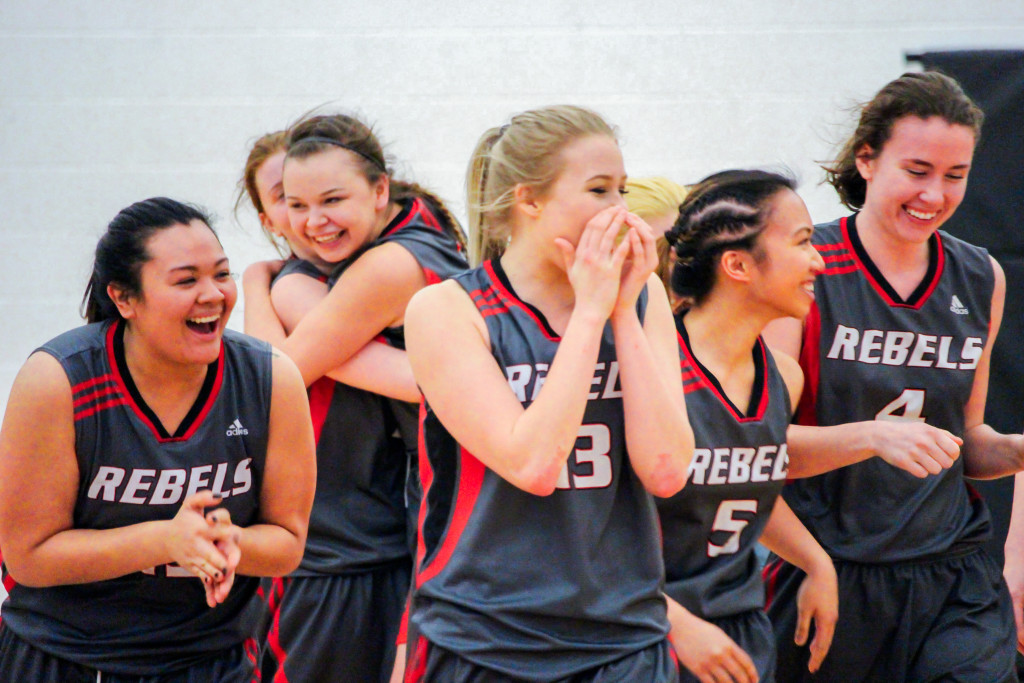 The Rebels women's basketball team celebrates after their 64-55 MCAC championship win over the Canadian Mennonite University Blazers on Sunday, Feb. 21. THE PROJECTOR/Gus Gottfred