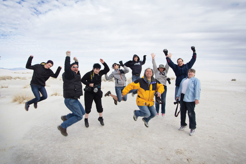 Photo Adventure Tour participants jump for joy at White Sands National Monument in Alamogordo, New Mexico. SUPPLIED/ Rodney S. Braun