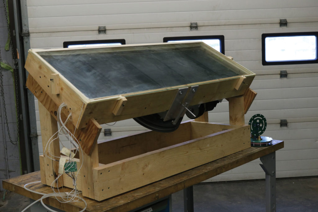 The flat plate solar Stirling engine prototype converts solar energy into mechanical power using common inexpensive materials. THE PROJECTOR/ Schuyler Hunt