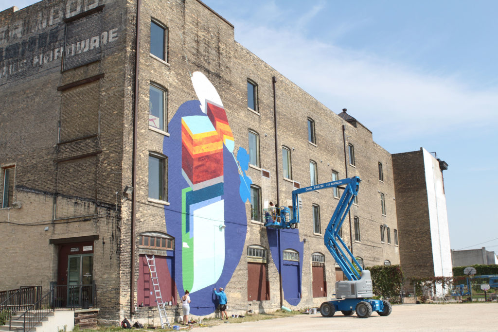 """Aqua Lungs"" by PA System and Par Josephee takes shape on the Winnipeg Centre Vineyard Church building at 782 Main St. THE PROJECTOR/ Jen Doerksen"