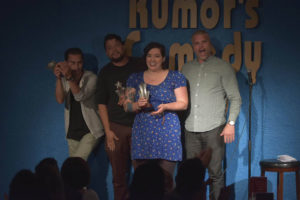 Host Ben Walker (right) crowns Ashley Burdett (middle) Winnipeg's Funniest Person with a Day Job at Rumor's Comedy Club. SUPPLIED/ Rumor's Comedy Club