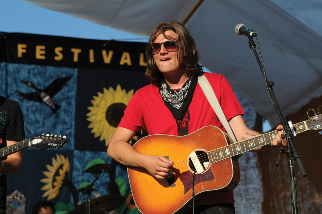 Kieran West of Kieran West & His Buffalo Band played new blues-rock tunes to a full field of people at Harvest Moon Festival. THE PROJECTOR/ Jen Doerksen