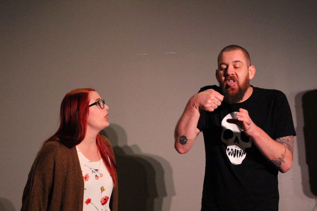 Mikaela (left) and Graham Myers (right) improvising a scene about tasting mild chili at the county fair. THE PROJECTOR/ Daniela Whelan