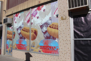 This Jesse Warkentin design was inspired by Winnipeg's food stands. The designs showed up on vacant downtown buildings in August. THE PROJECTOR/ Kathryn Sequeira