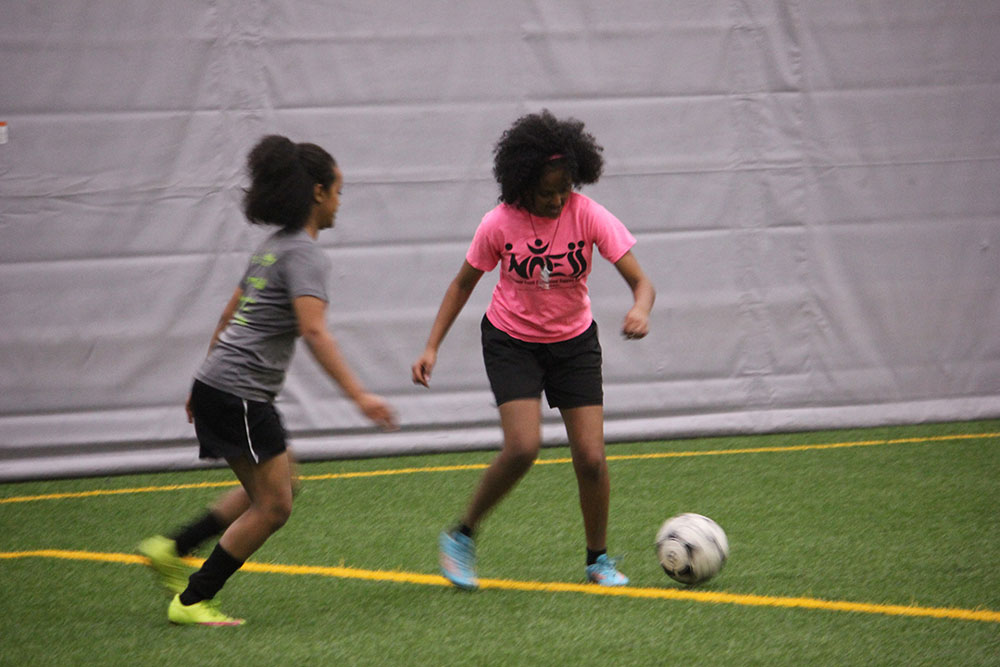 The two players from Sudan on the IRCOM girl's U-18 soccer team, Selam Kidane and Ayda Mahary perform a defense versus offense drill during their team's practice. THE PROJECTOR/ Woods Fines