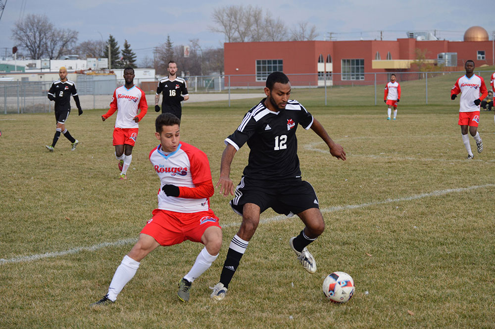 RRC's Awot Btseamlak protects the ball from Les Rouges's Sami Atoui. SUPPLIED/ Norm Konowalchuk