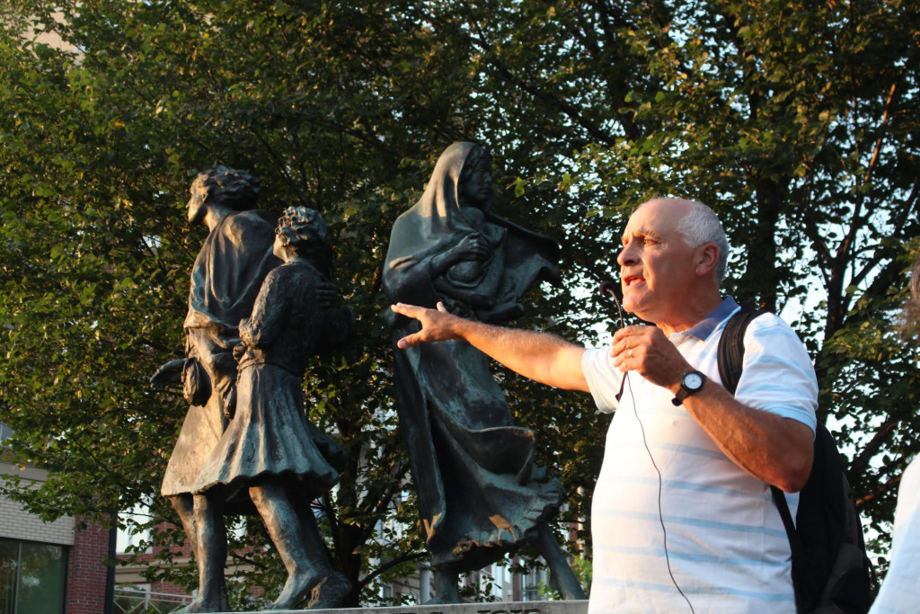 Historian Greg Thomas at the base of the Selkirk Settlers Monument on Waterfront Drive. THE PROJECTOR/Rachel Carlson