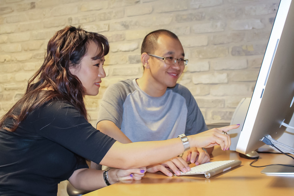 Pictured left to right: Jenny Petersen, an ESL tutor, helps Nianguang Cai at the Roblin Centre's ASC. Cai, a Business Information Technology student at Red River, is glad the new guidelines will allow him to continue bettering himself professionally. THE PROJECTOR/STEFANIE LASIUK