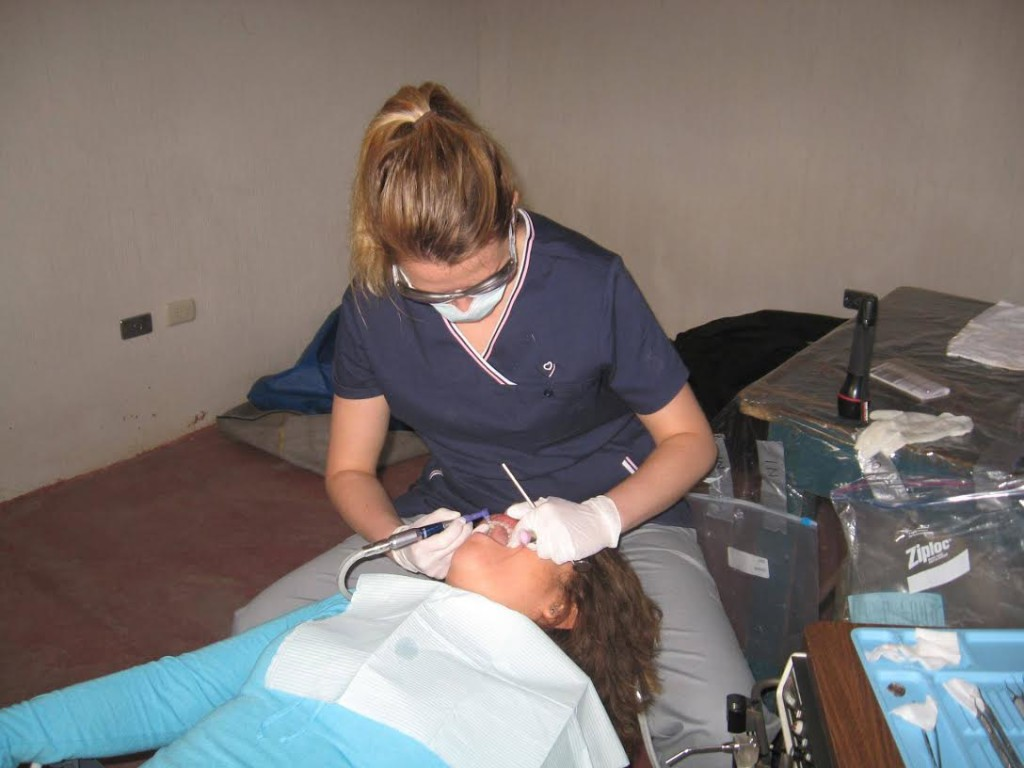 Red River College dental assisting grad Taylor Nickel working on a patient in Guatemala. SUPPLIED/Taylor Nickel