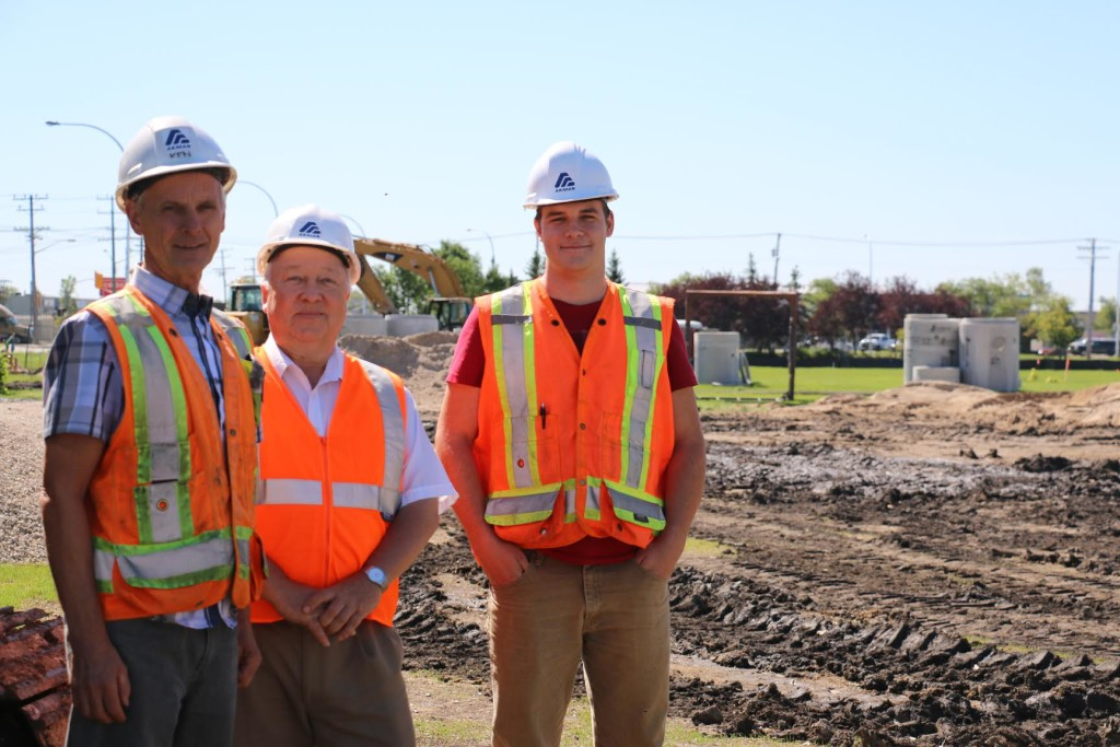 General supervisor Ken Harasyn, project manager Patrick Kuzyk and RRC alumni Joshua Wells stand where the new Skilled Trades and Technology Centre will be at the Notre Dame Campus. The three, and the rest of the team, have been working on the project since May. THE PROJECTOR/Samantha Samson