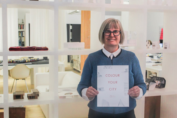 Susan Algie, director of the Winnipeg Architecture Foundation, shows off the recently released adult colouring book, Colour Your City. THE PROJECTOR/ Will Bazan