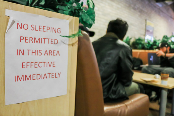 : Signs prohibiting sleeping hang near lounge couches at EDC. Some students say the downtown campus has limited places to relax. THE PROJECTOR / Christine Ahrens