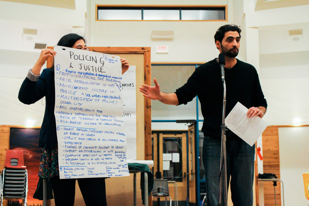 Fadi Ennab reports back on topics of policing and justice to attendees after a focused group discussion during the first fir e at Thunderbird House. THE PROJECTOR/ Jennifer Doerksen