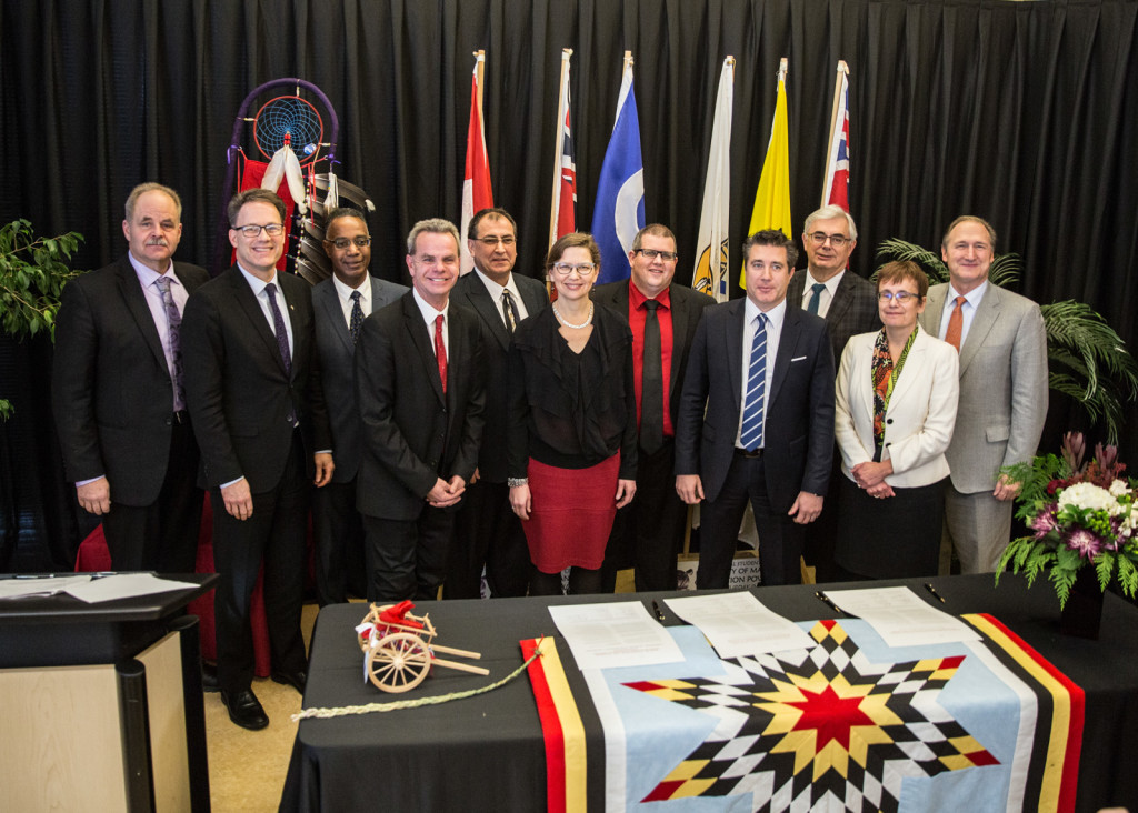 The signatories of the Indigenous Education Blueprint stand together at the University of Manitoba's Migizii Agamik Bald Eagle Lodge. SUPPLIED