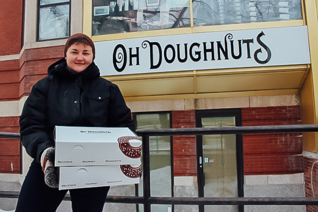 Amanda Kinden stands outside Oh Doughnuts' new home at 326 Broadway. She expects doors to open early March. THE PROJECTOR/ Joy K. Balmana