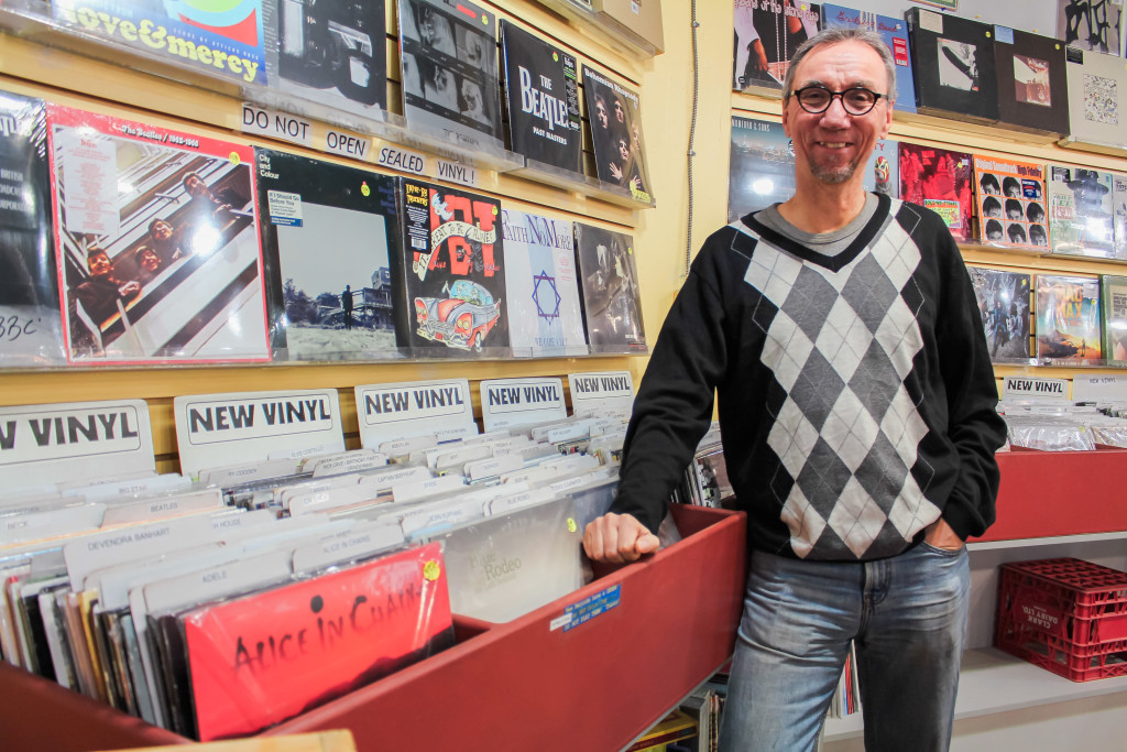 Manager of Into the Music, Greg Tonn, stands beside the new vinyl section of the store.