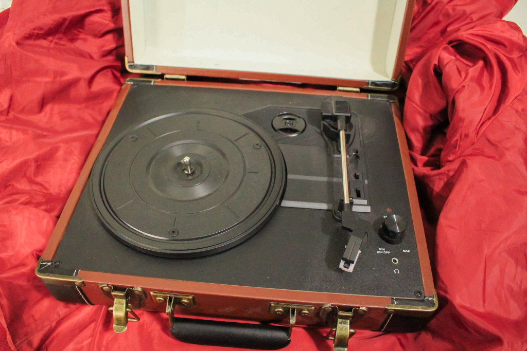 Portable suitcase turntables are one way beginners can listen to their new records. THE PROJECTOR/ Bailee Woods