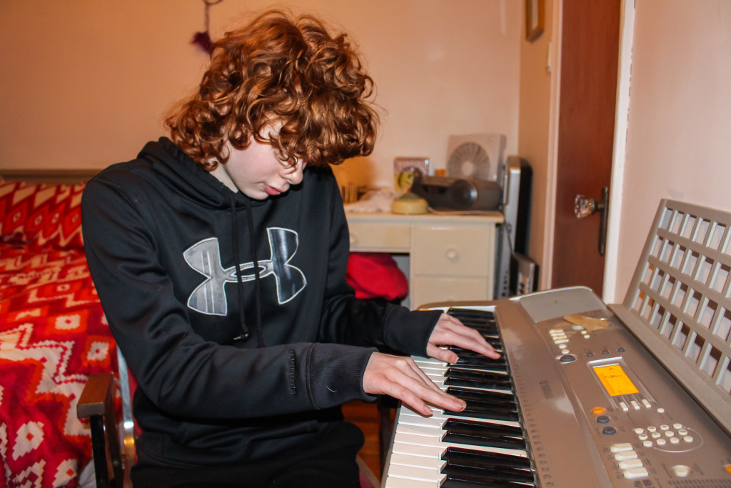 """Hope Pierre, 18, plays """"Here I Am,"""" the song she composed with the help of her middle school music teacher, Mrs. Hamilton. Music therapy has helped Pierre improve her attention span and social skills. THE PROJECTOR/Rebecca Dahl"""