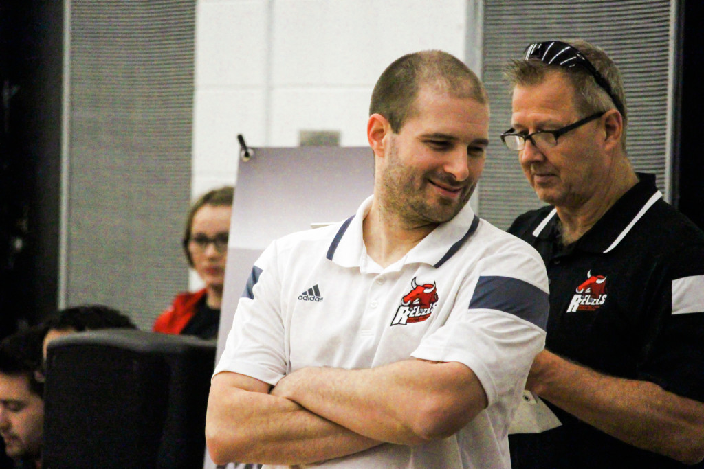 Rebels men's basketball coach Scott Kirkpatrick smiles as the clock runs out on RRC's 87-74 championship win over the Canadian Mennonite University Blazers on Sunday, Feb. 21. THE PROJECTOR/ Gus Gottfred