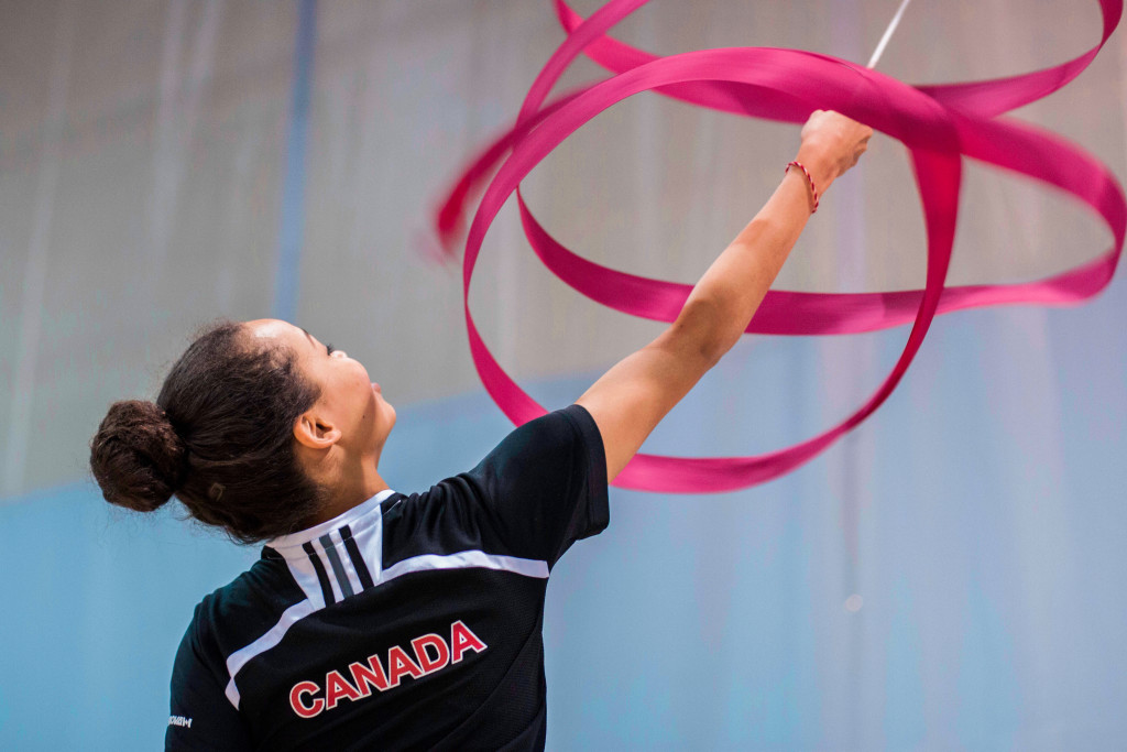 """Kaedyn Lashley, 16, practices a """"tor nado"""" with her ribbon at an after noon practice at the Max Bell Centr e field house. THE PROJECTOR/ Kristi Nikkel"""
