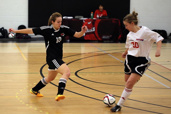 Stephanie Morris fights for the ball in a match against the Université de Saint Boniface Les Rouges on February 22, 2016. SUPPLIED/ Ben Wettlaufer
