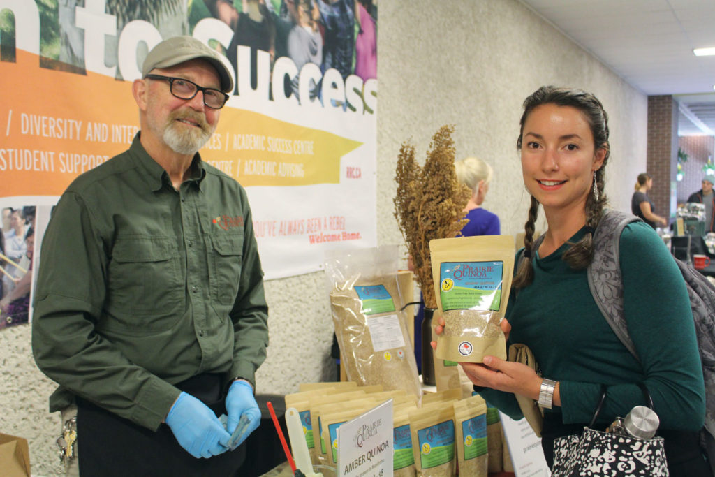 Angele Gauthier, a nursing student, bought a bag of quinoa from Percy Phillips at Red River College's farmers market Sept. 9. THE PROJECTOR/ Kaitlin Vitt