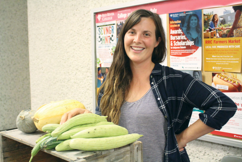 Britt Embry sold produce from her farm, Hearts & Roots. THE PROJECTOR/Kaitlin Vitt