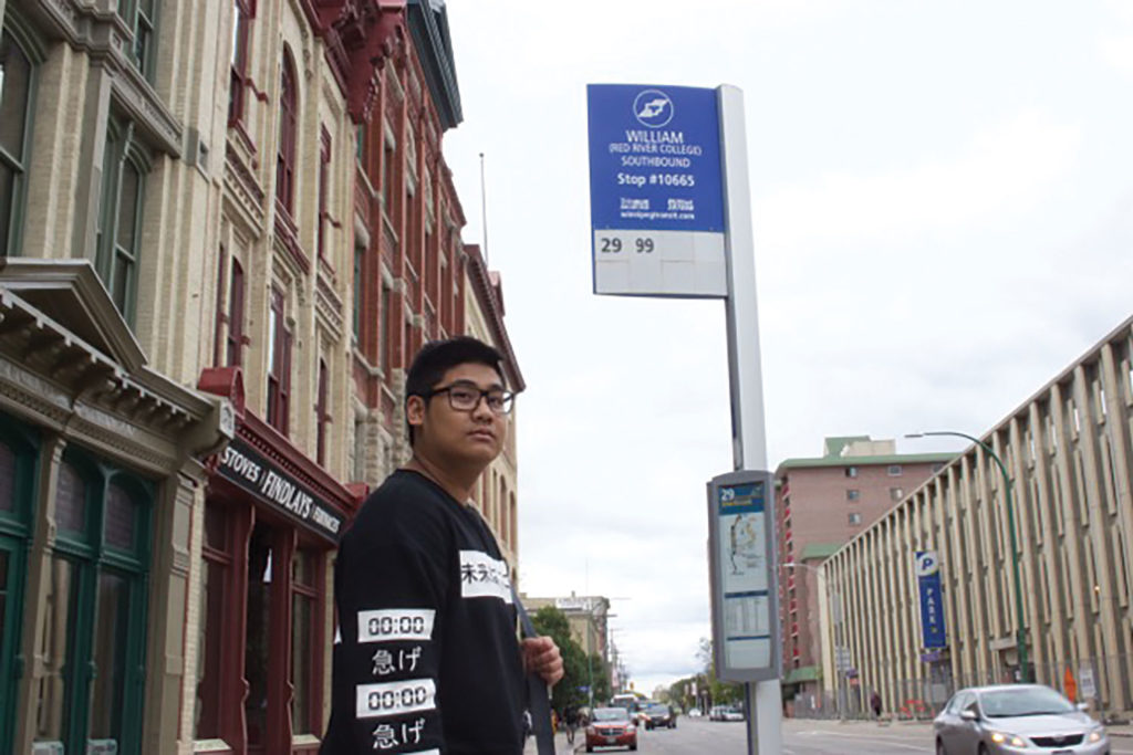 Kenn Limpin, 19, said he uses transit, because parking near the Exchange District Campus is too expensive./COURTNEY BANNATYNE