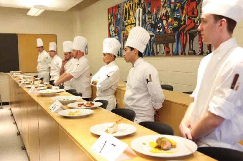 "Mackenzie Ferguson (far right) 25, awaited the results at a Jeunes Chefs Rôtisseurs competition. Ferguson would go on to win third in the competition and the title of ""top kitchen score."" SUPPLIED/ Chaine des Rotisseurs Canada."