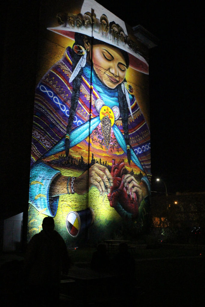 """""""Mending"""", by Bruno Smoky and Shalak Attack speaks to murdered and missing Indigenous women and colonial history. Located on the south-facing wall of 782 Main Street. THE PROJECTOR/ Jen Doerksen"""