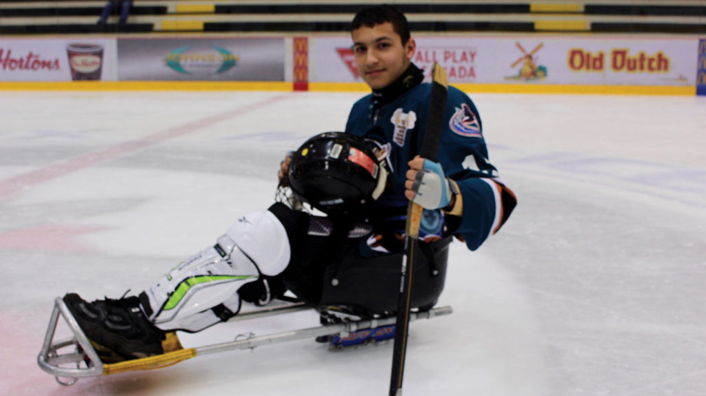 Omar Al-Ziab, 15, happy with his new home, new friends and new found passion – sledge hockey. THE PROJECTOR/ Zac Easton