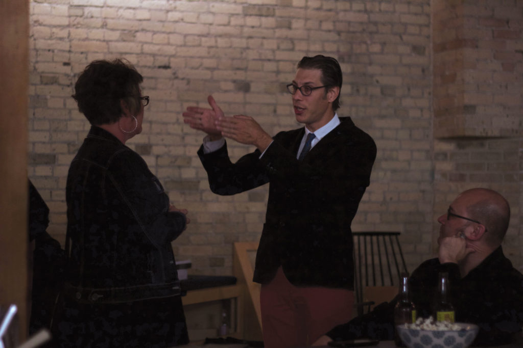 Executive Director, Leif Norman (right) chats with guests at the Flash Photographic Festival's kick-off party at Fourth on October 3, 2016. THE PROJECTOR/ Ashlyn Peterson