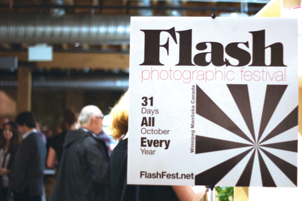 Crowds gather at the 3rd annual Flash Photographic Festival kick-off party. THE PROJECTOR/ Ashlyn Peterson