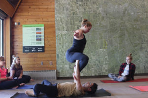 Festival goers learned different acro-yoga poses in a workshop guided by Ken Wong in Fort Whyte's Prairie Partners Room. THE PROJECTOR/ Maggie Wysocki