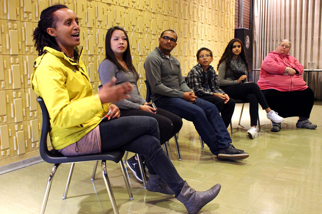 13 Fires Panel in the middle of their discussion (R-L) Bemnet Hailegiorgis, Raven Michelle, Wilson Peinado, Maximus Brydon, Mahirah Rakhashani, Laura Rose. Panel disscussion on racial diversity/inclusion at R. B. Russel School. Oct. 29, 2016. THE PROJECTOR/ Saz Massey