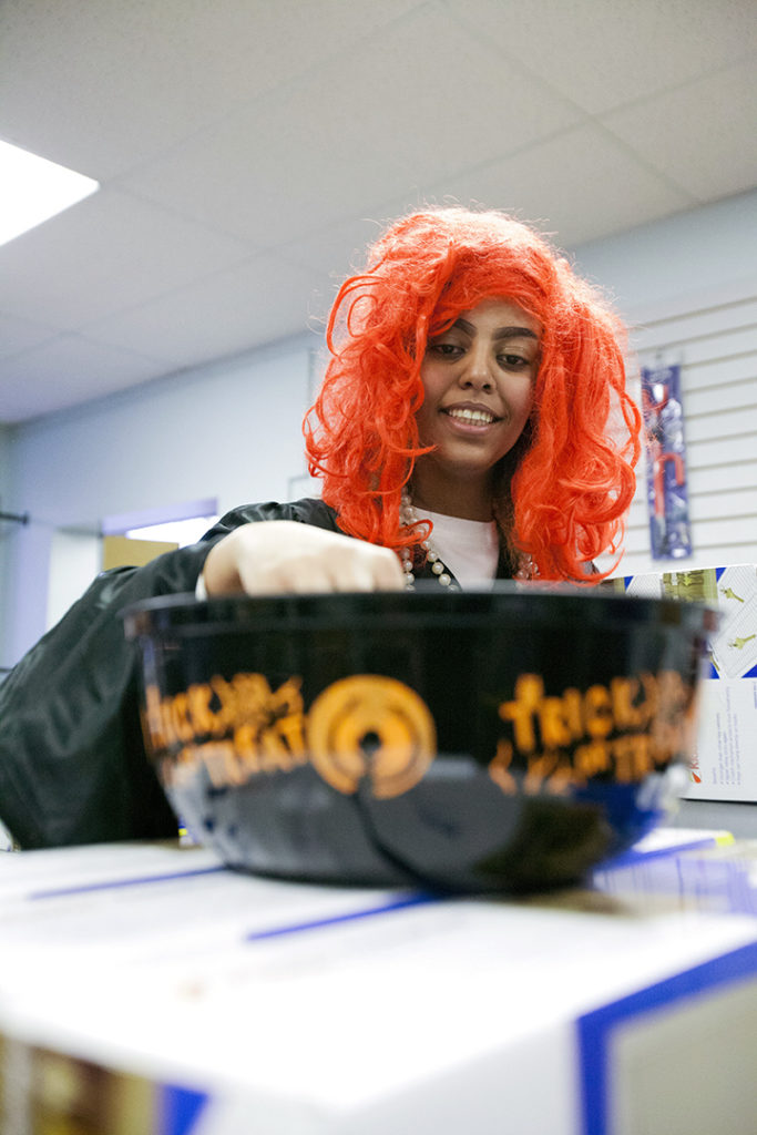 Besma Salih digs into a bowl of candy at the N.E.E.D.S. Centre's Halloween event. THE PROJECTOR/ Erik Pindera