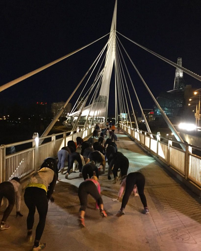 November Project participants complete the bridge challenge, one of the group's SUPPLIED / NOVEMBER PROJECT