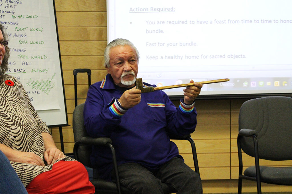 Elder Jules Lavallee shows a pipe with the spirit of the turtle before the pipe ceremony. THE PROJECTOR/ Joshua Houston